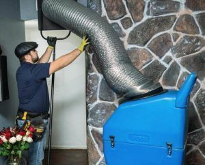 Air Duct professional with the Cleaning Machine
